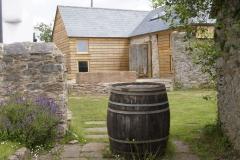 Barn House with cider barrel