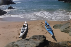 secluded beach on sea kayaking holiday